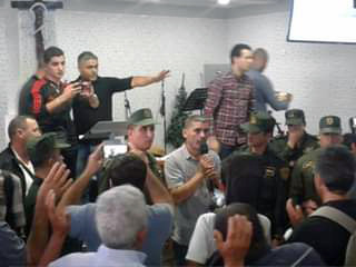 Special police forces (in green) remove worshippers from an Algerian church.