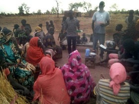 One of the team members preaches to a group of villagers.