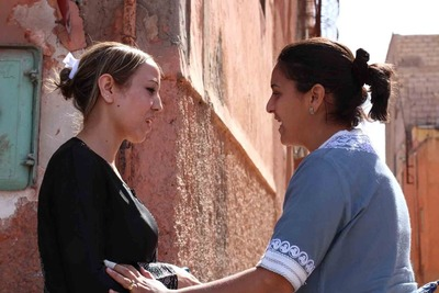 A woman sharing the gospel in Morocco.