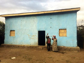 This family received a new house after theirs was destroyed in the 2017 attacks.