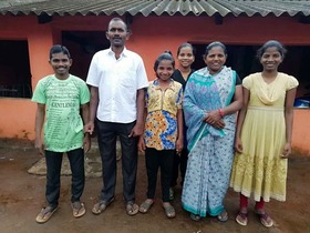 Bijaya, second from the left, was reunited with his wife and children after more than 10 years.